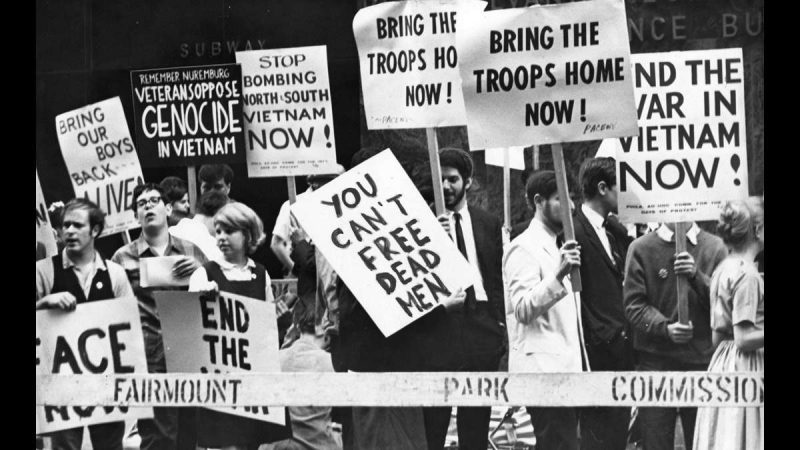 Protesting the war in Vietnam, demonstrators march on Broad Street opposite the Bellevue-Stratford Hotel on May 23, 1966, where Vice President Hubert H. Humphrey received the National Fellowship Award. (Richard Rosenberg / Courtesy of George D. McDowell Philadelphia Evening Bulletin Collection, Temple University Libraries)