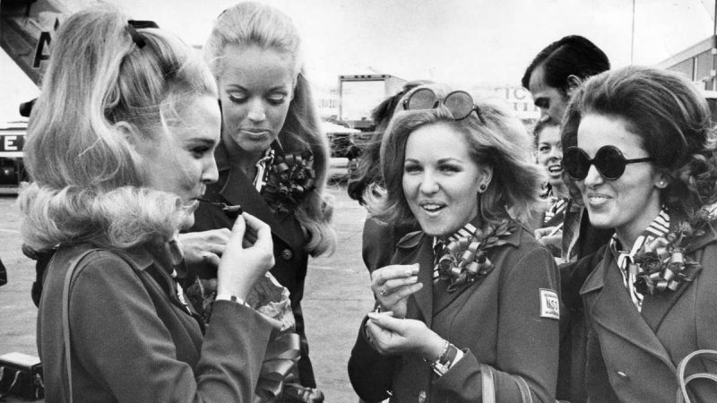 Miss America, Pamela Anne Eldred, shares a bag of cherries she brought from Atlantic City for the trip with Susan Anton, Miss California; Mary Cox, Miss Tennessee; and Ann Fowler, Miss Alabama, just before boarding their flight on Aug. 10, 1970. (Raymond F. Stubblebine / Courtesy of George D. McDowell Philadelphia Evening Bulletin Collection, Temple University Libraries)