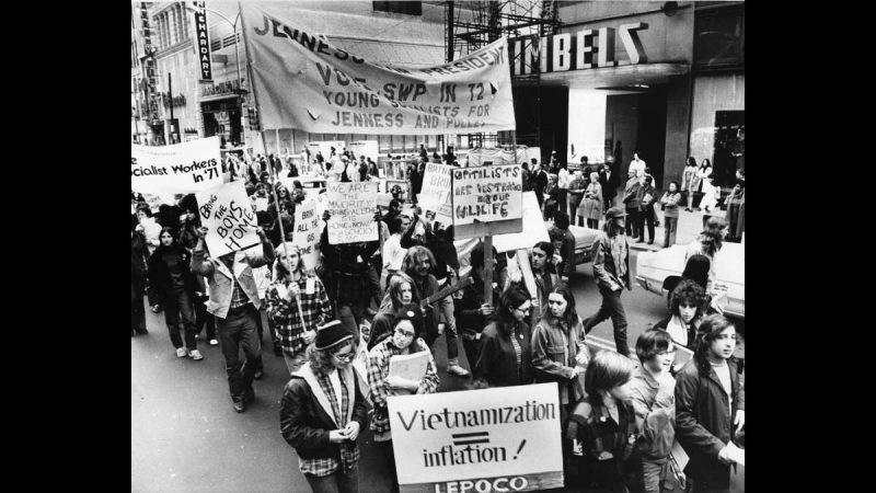 Anti-war demonstrators are shown marching along Market Street between Sixth and Eighth streets on Oct. 6, 1971. Gimbel Brothers and Horn and Hardart stores can be seen on the right. (Dominic Pasquarella / Courtesy of George D. McDowell Philadelphia Evening Bulletin Collection, Temple University Libraries)
