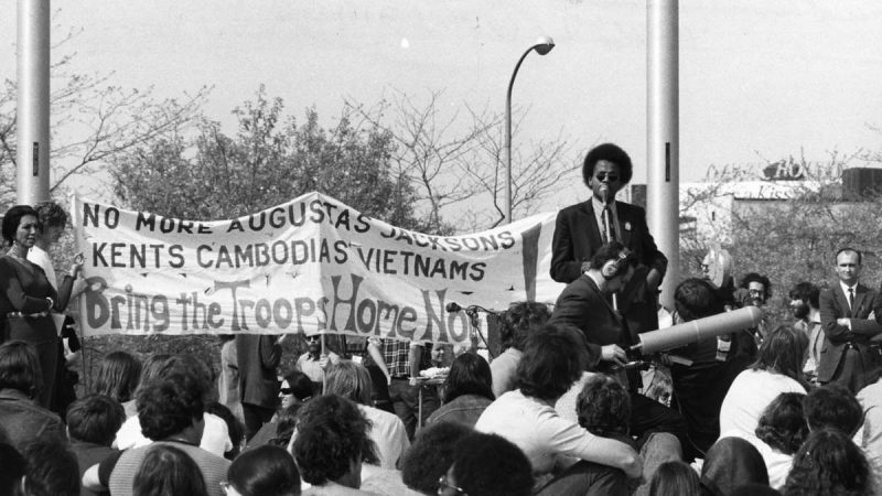 Anti-war demonstrators protest in remembrance of those who died at Kent State University and Jackson State College. The commemoration was held at Independence Mall on May 5, 1971. Gene Young, a student government leader from Jackson State, addresses the crowd. (Joshua Bernstein / Courtesy of George D. McDowell Philadelphia Evening Bulletin Collection, Temple University Libraries)