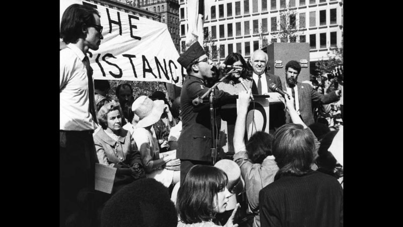 "Army Pfc. George Fields, in uniform, tells anti-war rally demonstrators in Philadelphia on May 1, 1969, that ""We're fighting for liberty."" Fields, 20, is a Vietnam veteran. At left is Robert Eaton, skipper of the pacifists' ship Phoenix, which took medical supplies to North Vietnam. (Maurice M. Upton / Courtesy of George D. McDowell Philadelphia Evening Bulletin Collection, Temple University Libraries)"