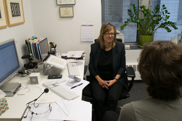 Alice Gorelick sits with Christie Block