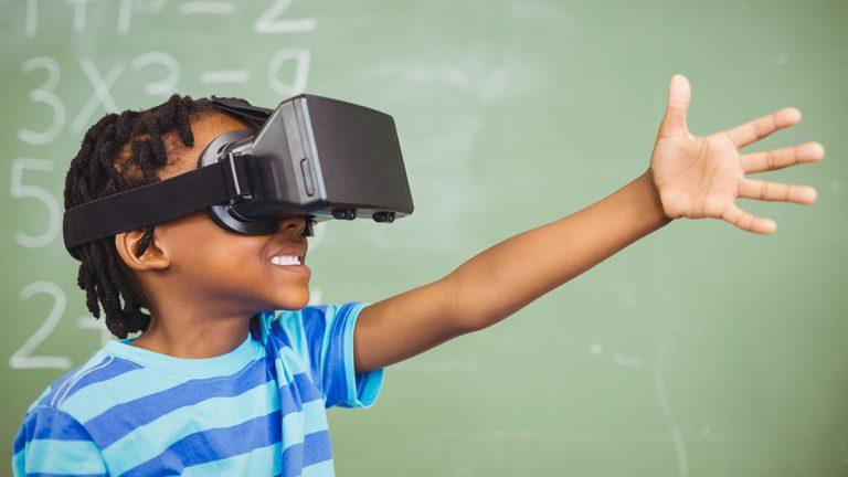 (<a href='https://www.bigstockphoto.com/image-137254502/stock-photo-school-boy-in-virtual-reality-glasses-in-classroom-at-school'>Wavebreak Media Ltd</a>/Big Stock Photo)
