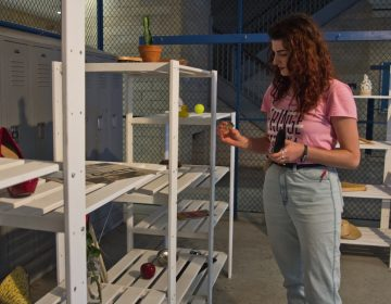 'Worktable' participants are invited to chose an object to take apart and reassemble before entering the rest of the exhibit. (Kimberly Paynter/WHYY)