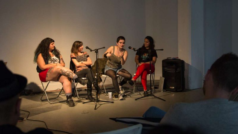 Sofia Ben-Hur (second from right), of the punk band Flwer Pnk, animatedly talks about their experience with idenity and religion as a MENA artist. (Emily Cohen for WHYY)
