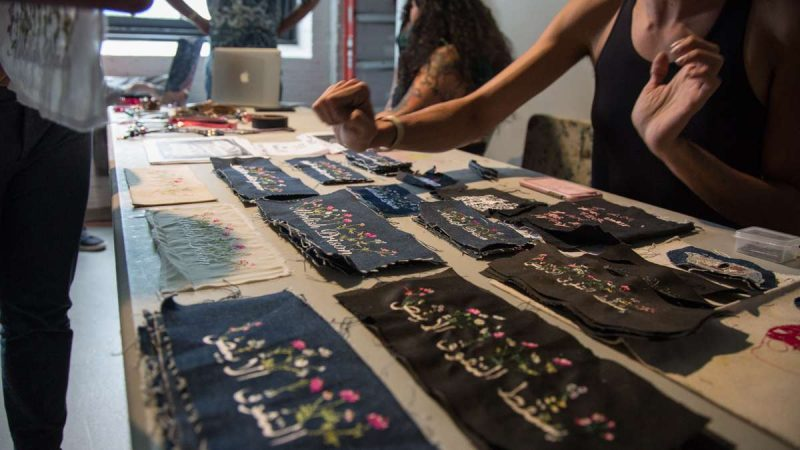 Rose Buttress sells her embroidered goods in the vendor section of YallaPunk. (Emily Cohen for WHYY)