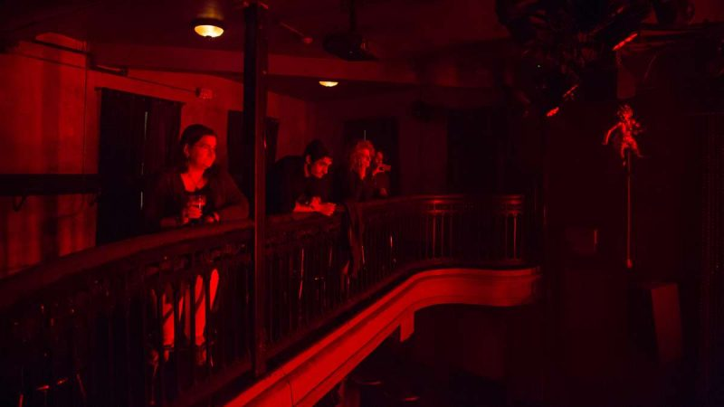 Attendees of the first YallaPunk Festival listen and vibe as punk band Night Raid performs at Johnny Brenda's in Philadelphia. (Emily Cohen for WHYY)
