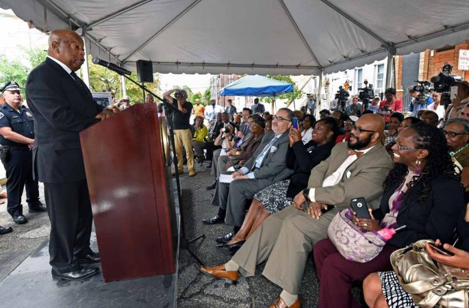 U.S. Rep. John Lewis addresses the crowd at the September 2016 press conference to announce the preservation of the Martin Luther King, Jr. house at 753 Walnut Street in Camden.  (April Saul/for WHYY)