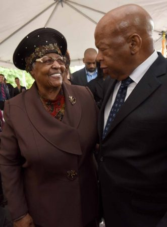 U.S. Rep. John Lewis and Jeanette Lily Hunt, who owns the house at 753 Walnut Street in Camden where Martin Luther King, Jr. stayed as a seminary student, meet at the September 2016 event to announce preservation of the property.  (April Saul/for WHYY)