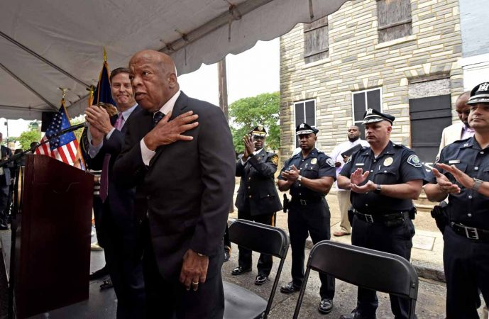 U.S. Rep. Donald Norcross, left; and U.S. Rep. John Lewis address the crowd at the September 2016 press conference to announce the preservation of the Martin Luther King, Jr. house at 753 Walnut Street in Camden.  (April Saul/for WHYY)