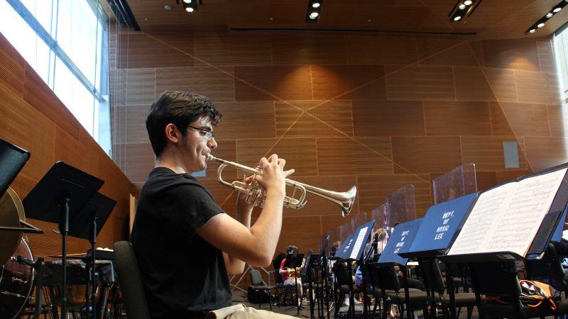 A trumpeter warms up in the Lee Music Performance and Rehearsal Room. (Emma Lee/WHYY)
