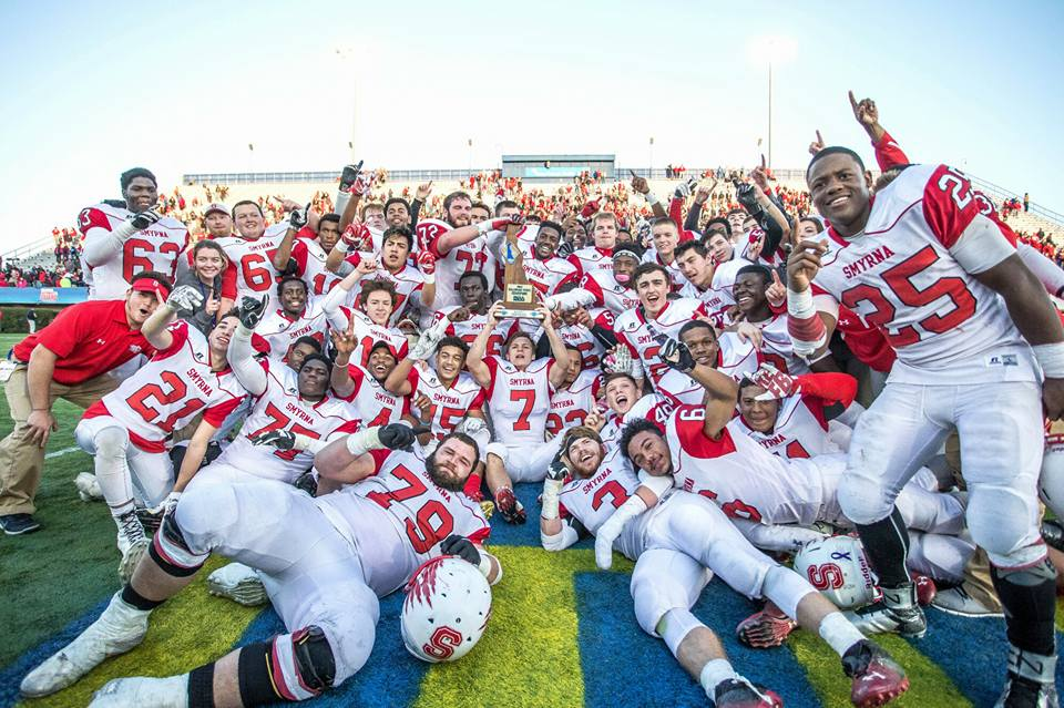 Smyrna High's football team rejoices on the field at the University of Delaware after winning its first state Division I football title in 2015 with a thrilling victory over perennial powerhouse Salesianum. (Courtesy of Smyrna High School)