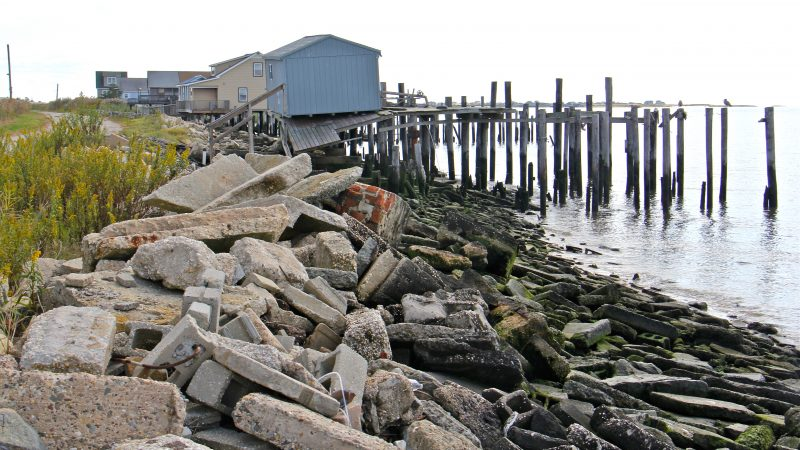 Construction debris litters the Bay Point beach where many homes were destroyed by Hurricane Sandy.
