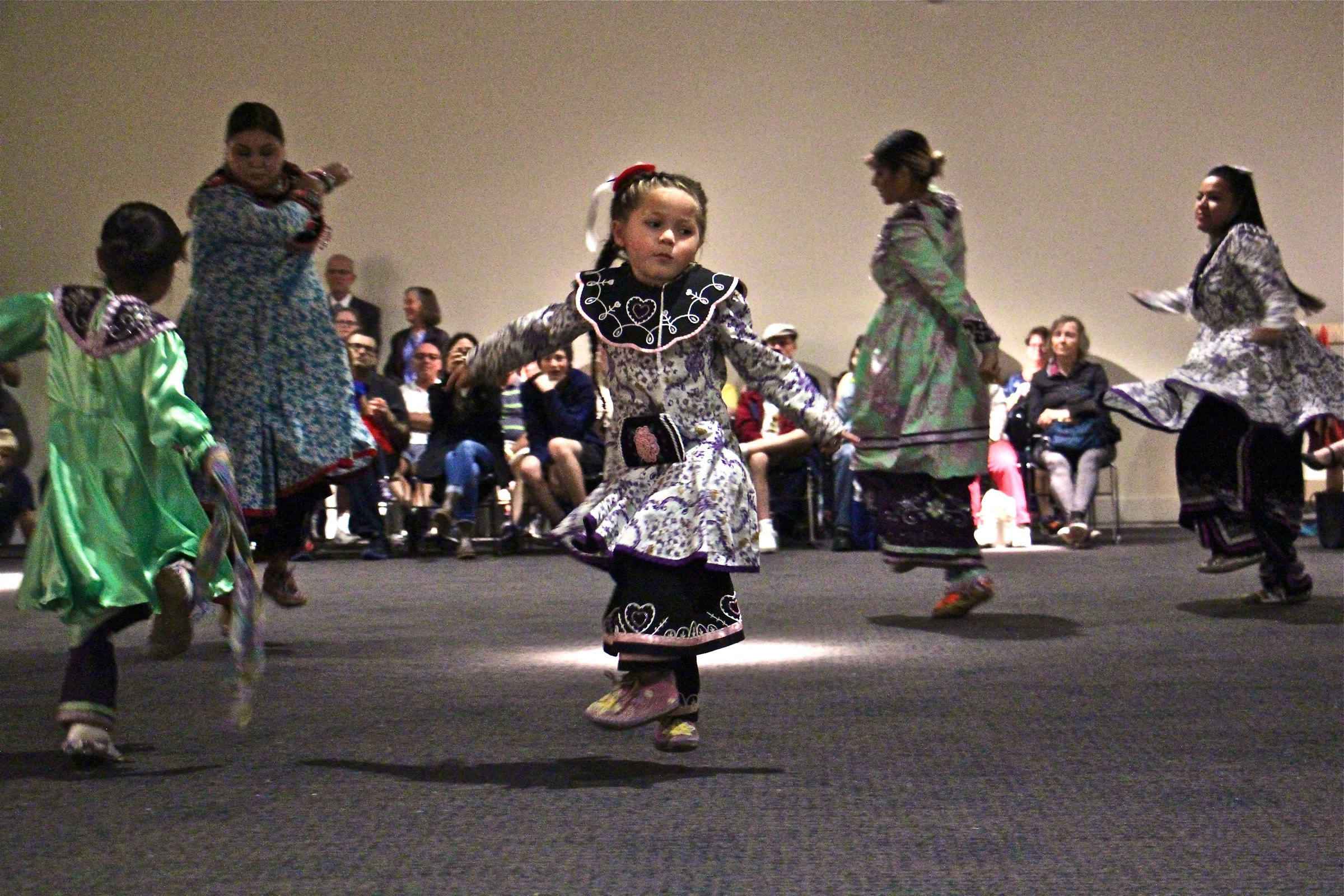 Reina Alice, 5, of the Oneida Nation performs with the Longhouse Singers and Dancers at the Museum of the American Revolution.