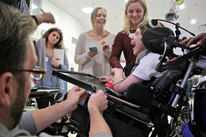 Temple occupational therapy students work to design a new wheelchair tray for Eddie