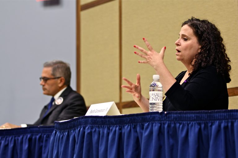 Candidates for Philadelphia district attorney, Republican Beth Grossman (right) and Democrat Larry Krasner, debate at La Salle University. (Emma Lee/WHYY)