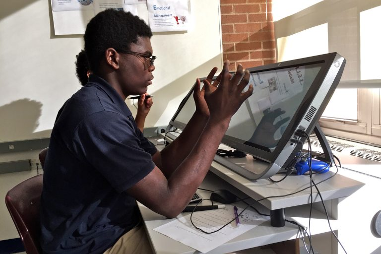 Oswald Darway, a 10th grader at Valley Day School, works with a virtual reality program.