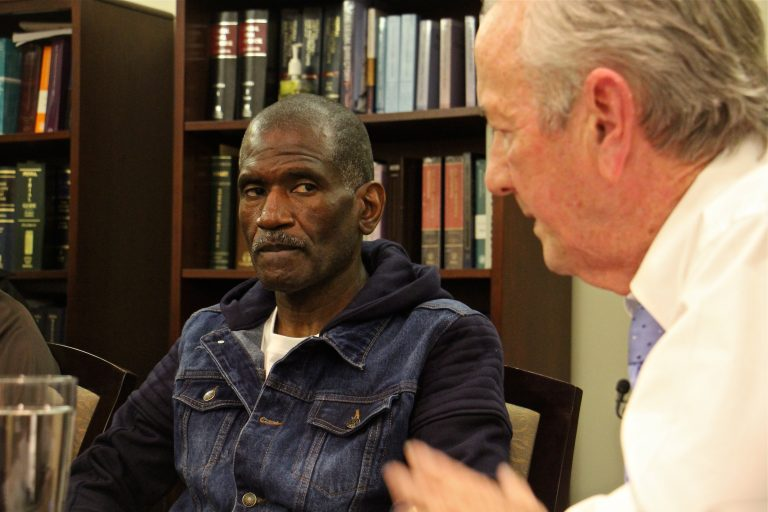 Kevin Brinkley (left) listens to an apology from attorney Gerald Dugan, who 40 years ago prosecuted the murder case that got Brinkley a life sentence. Dugan has since changed his mind about Brinkley's role in the murder of Charles Haag