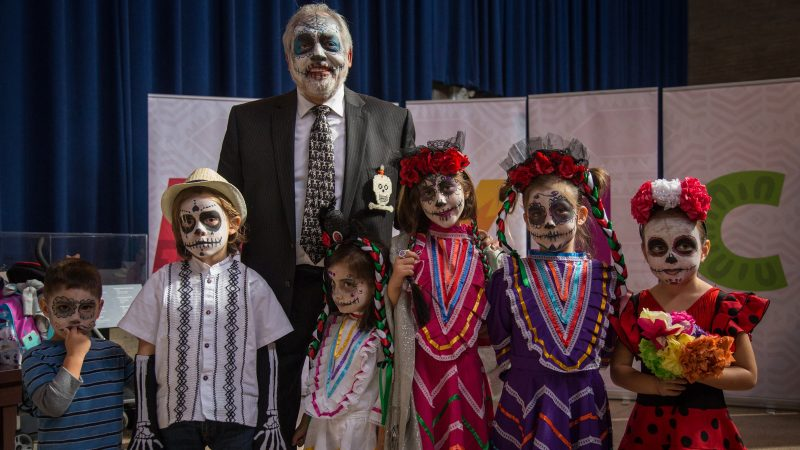 A. Peter Ojeda stands with his grandchildren all in traditional sugar skull face paint in celebration of Dia de los Muertos at Penn Museum's annual Day of the Dead