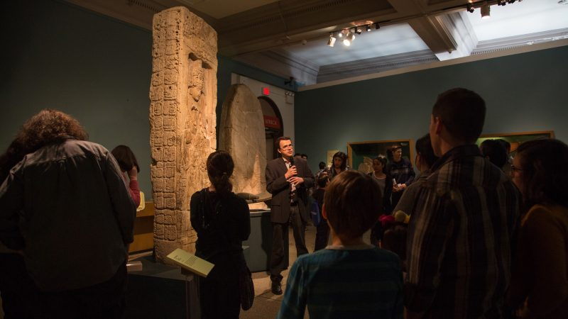 Simon Martin, Penn Museum curator, gives a tour of the museum's collection of monoliths and other artifacts in the Mexico and Central America gallery