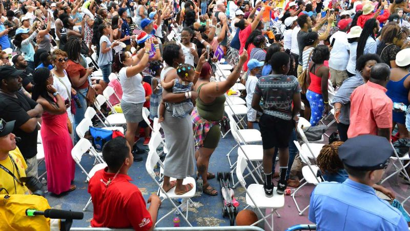 Members of the audience in the seated section enjoy the music during the Fourth of July concert on the Parkway.