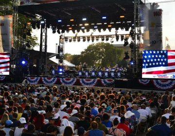 The seated section of the audience enjoys the music during the Fourth of July concert on the Parkway.