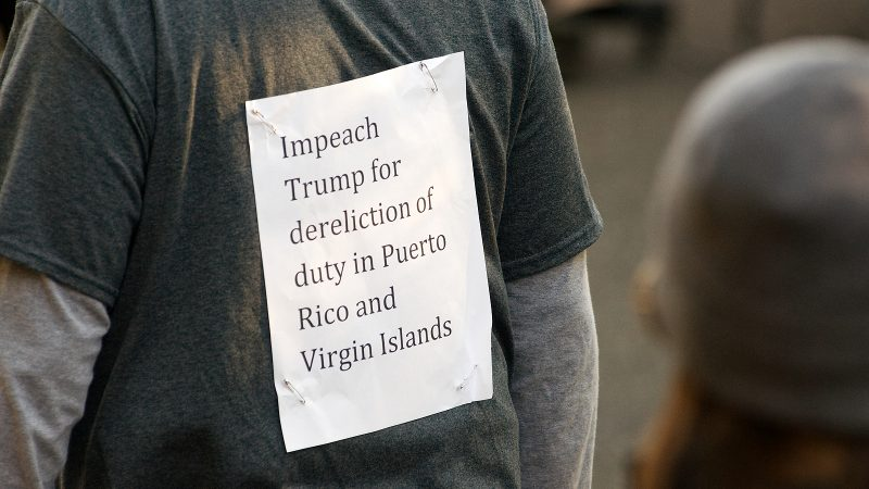 Victor Edgar Rivera, of South Jersey, protests the response of the Trump administration to the growing humanitarian crisis on Puerto Rico and the Virgin Islands. (Bastiaan Slabbers for WHYY)