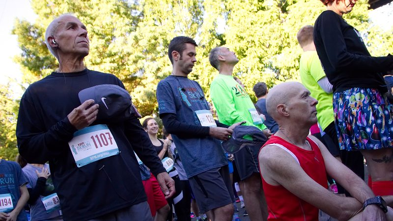 Kevin Peter, of West Mt. Airy, takes a knee in protest during the National Anthem at the start of the WXPN 5K, on Sunday. (Bastiaan Slabbers for WHYY)