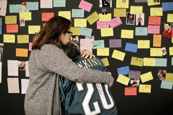 The memories of overdose victims are postedont a Memory Wall at the Regional Candlelight Vigil at Camden Waterfront Stadium on October 14, 2017. (Bastiaan Slabbers for WHYY)
