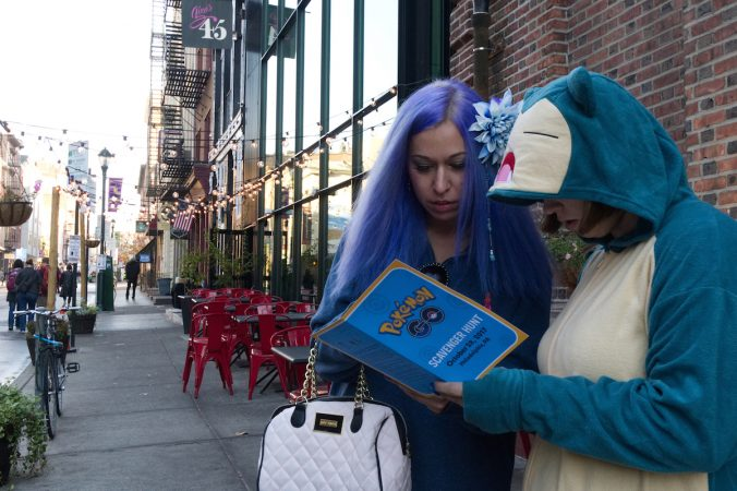 Stephanie Clark end Cassy Golden traveled from Baltimore to attend the Pokémon Scavenger Hunt during Philly Free Streets on North Third Street, Saturday, Oct. 28, 2017. (Bastiaan Slabbers for WHYY)