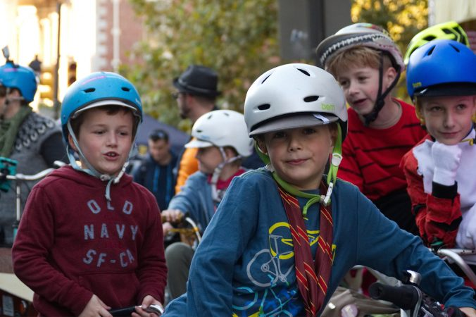 Children at the start of a family bike ride during Philly Free Streets, Saturday, Oct. 28, 2017. (Bastiaan Slabbers for WHYY)