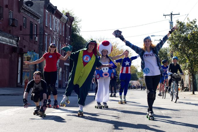 Members of Philly Roller Derby pose for photos during Philly Free Streets on N. 5th Street, Saturday, Oct. 28, 2017. (Bastiaan Slabbers for WHYY)