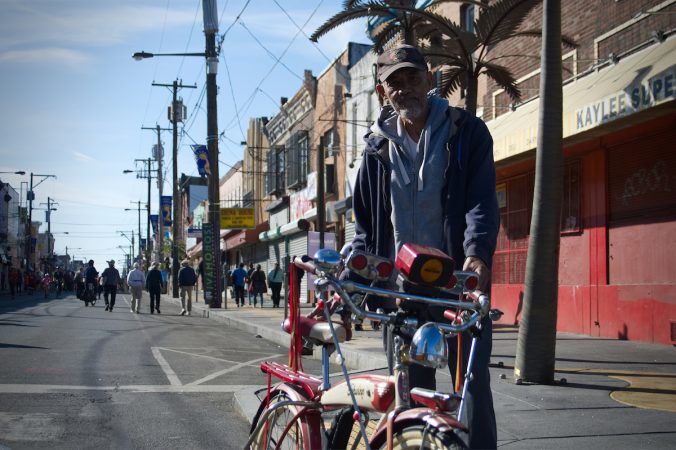 Hector Colon stands next to a vintage cruiser during Philly Free Streets,  Saturday, Oct. 28, 2017. (Bastiaan Slabbers for WHYY)