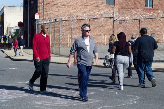 Philadelphia Mayor Jim Kenney keeps up the pace as he power-walks the route of Philly Free Streets, Saturday, Oct. 28, 2017. (Bastiaan Slabbers for WHYY)