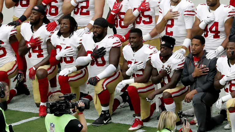 Members of the San Francisco 49ers kneel during the national anthem as others stand prior to an NFL football game against the Arizona Cardinals, Sunday, Oct. 1, 2017, in Glendale, Ariz.