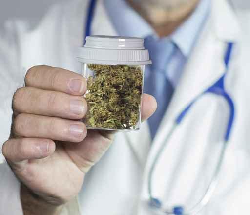 Doctor holding medical marijuana
