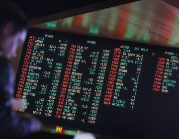 In this Jan. 14, 2015, file photo, odds are displayed on a screen at a sports book owned and operated by CG Technology in Las Vegas. (John Locher/AP Photo, File)