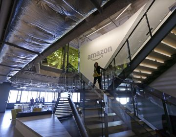 An Amazon worker walks down steps in a company office before an event announcing several new Amazon products by the company, Wednesday, Sept. 27, 2017, in Seattle. (Elaine Thompson/AP Photo)