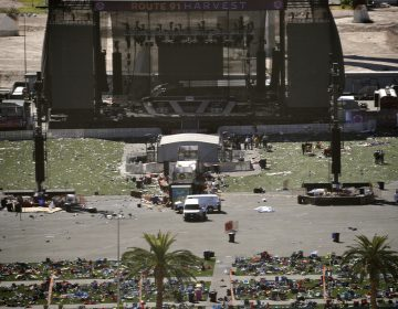 Debris is strewn through the scene of a mass shooting at a music festival near the Mandalay Bay resort and casino on the Las Vegas Strip, Monday, Oct. 2, 2017, in Las Vegas. (AP Photo/John Locher)