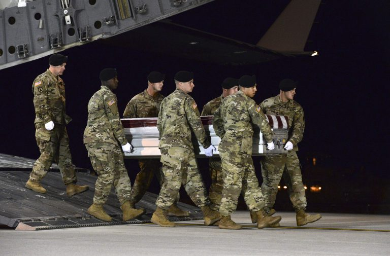 In this image provided by the U.S. Air Force, a U.S. Army carry team transfers the remains of Army Staff Sgt. Dustin Wright of Lyons, Ga., late Thursday, Oct. 5, 2017, upon arrival at Dover Air Force Base, Del. Wright, 29, of Lyons, Ga., was one of four U.S. troops and four Niger forces killed in an ambush by dozens of Islamic extremists on a joint patrol of American and Niger Force.