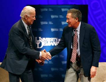 Former Vice President Joe Biden, left, and Ohio Gov. John Kasich shake hands after participating in a discussion on bridging political and partisan divides at the University of Delaware in Newark, Del., Tuesday, Oct. 17, 2017. (AP Photo/Patrick Semansky)
