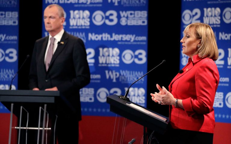 Republican nominee Lt. Gov. Kim Guadagno, right, answers a question during a gubernatorial debate against Democratic nominee Phil Murphy at William Paterson University in Wayne, N.J.  (AP Photo/Julio Cortez, pool)
