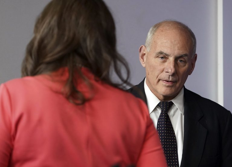 White House Chief of Staff John Kelly walks past White House press secretary Sarah Huckabee Sanders to begin speaking to the media during the daily briefing in the Brady Press Briefing Room of the White House, Thursday, Oct. 19, 2017.