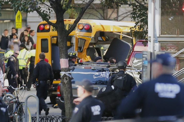 Authorities respond near a damaged school bus Tuesday, Oct. 31, 2017, in New York. A motorist drove onto a busy bicycle path near the World Trade Center memorial and struck several people on Tuesday police and witnesses said.