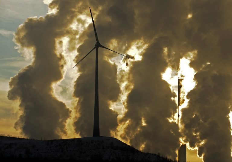 In 2010 file photo, a wind turbine is pictured in the in front of a steaming coal power plant in Gelsenkirchen, Germany.