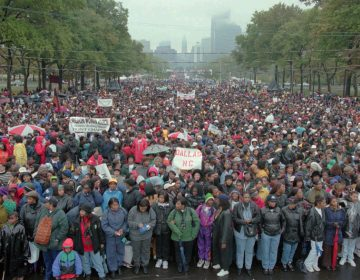 A crowd of people fill the Parkway