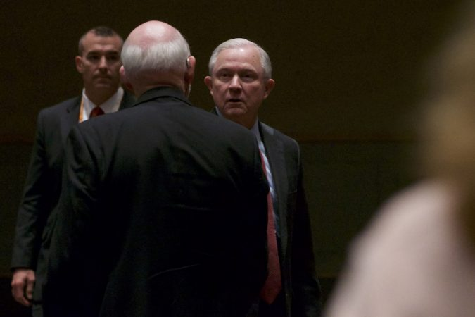Sessions shaking hands after a speach