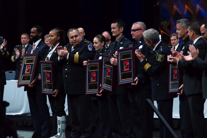 Recipients of Police Officer of the Year awards are recognized on stage during the General Assembly of the International Association of Chiefs of Police convention in Philadelphia. (Bastiaan Slabbers for WHYY)