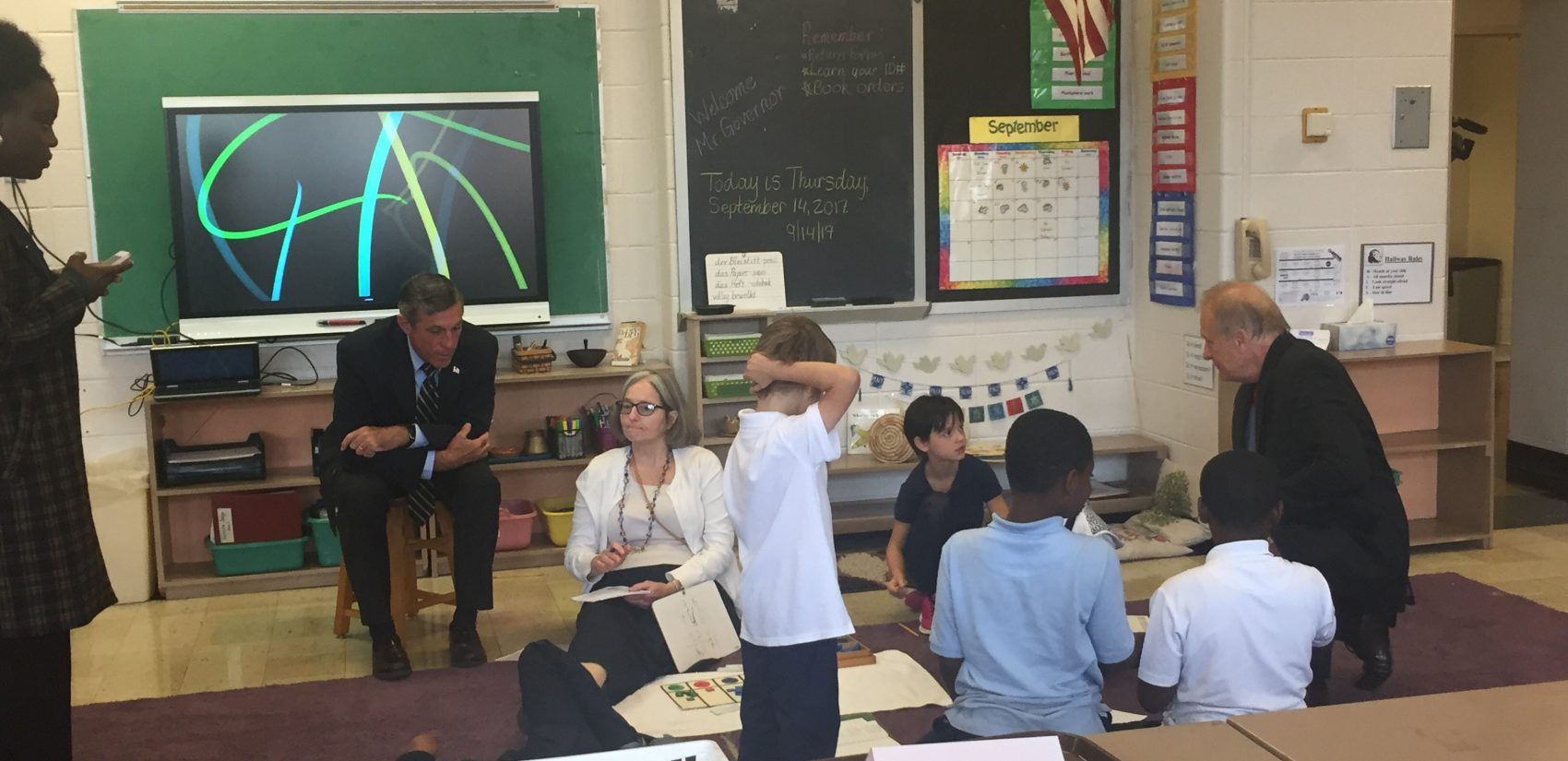 Gov. John Carney (seated) recently visited Bancroft Elementary, which has barely one-third of its seats filled. Carney said Christina School District leaders must make