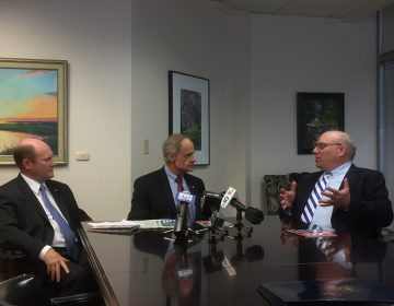 Delaware U.S. Senators Chris Coons and Tom Carper talk with chairman of the group Patriotic Millionaires Morris Pearl. (Zoë Read/WHYY)